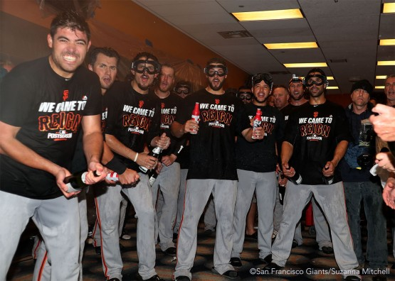 The team waits for Conor Gillaspie to enter the clubhouse.