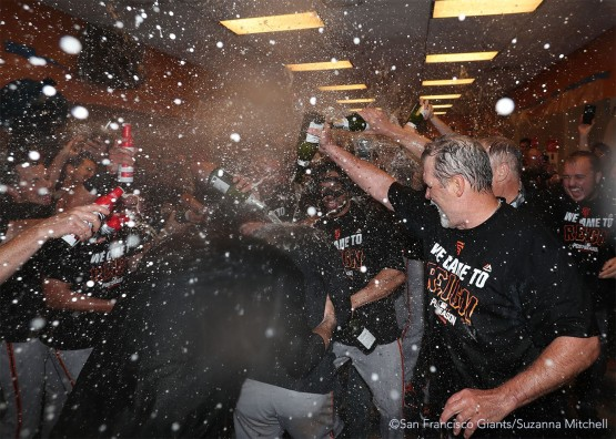 Conor Gillaspie receives a champagne shower as he enters the clubhouse.