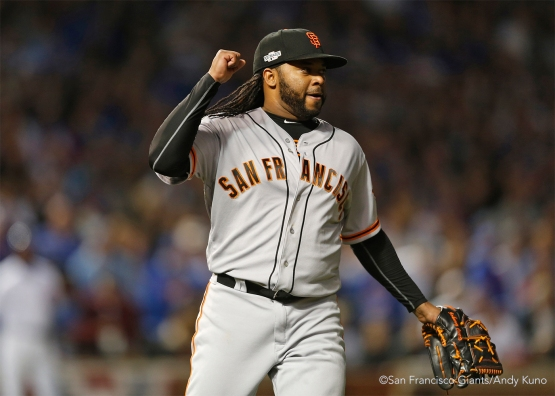 Johnny Cueto reacts after striking out the side in the sixth inning.