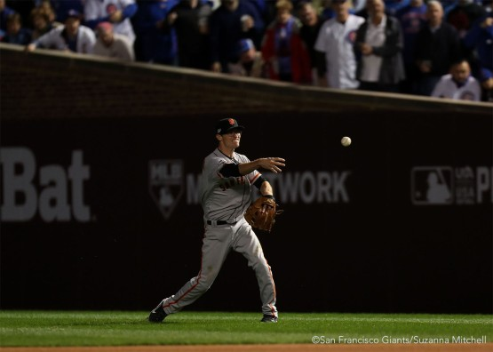 Kelby Tomlinson throws out Anthony Rizzo in the seventh inning.
