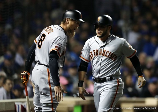 Hunter Pence and Gregor Blanco celebrate after Blanco scored on a sacrifice fly hit by Brandon Belt in the third inning.