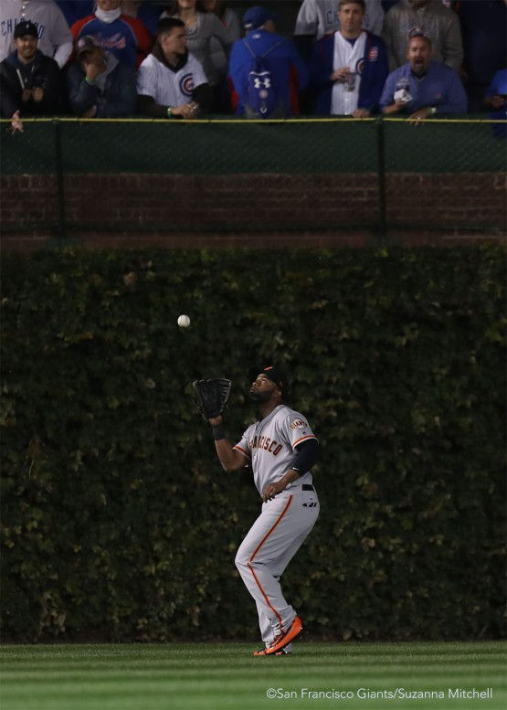 Denard Span catches a fly ball in center field hit by Addison Russell in the eighth inning.
