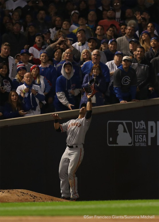Angel Pagan catches a foul ball hit by Anthony Rizzo in the second inning.