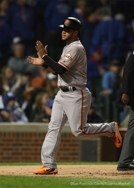 Gregor Blanco crosses the plate after scoring on a sacrifice fly hit by Brandon Belt.