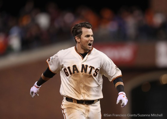 Joe Panik celebrates after doubling in the thirteenth inning to score Brandon Crawford for the winning run.
