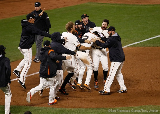Joe Panik is mobbed after doubling to win the game.