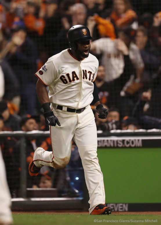 Denard Span celebrates after scoring on a sacrifice fly hit by Brandon Belt during the fifth inning.