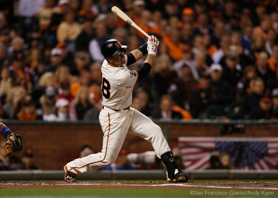 Buster Posey singles in the third inning.