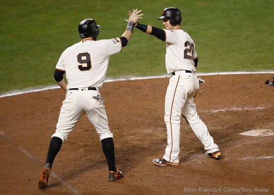Brandon Belt and Buster Posey celebrate after scoring the tying and go ahead runs in the eighth inning.